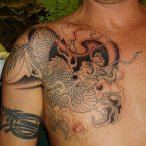Unfilled Dragon and Smoke Tattoo