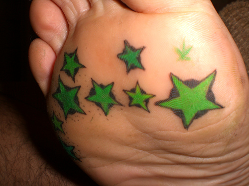 Green stars at the bottom of foot. Normally tattoos